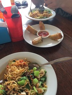 One bowl of Soto ayam (chicken noodle soup) , one order of lumpia and one bowl of mie goreng (pan fried noodles). 55,000 IDR= $4.10. Delicious food stall in Bali.