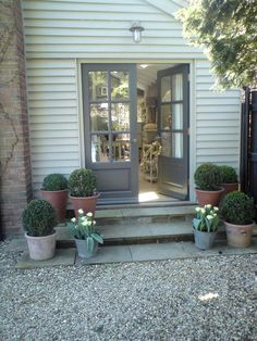 Choosing a style of patio doors for garden room Grey French Doors With Box Plants And Tulips - Image By Alison Dodds Gravel Patio, Concrete Patio, Backyard Patio, Entrance Doors, Patio Doors, Front Door Steps, Side Door, Cottage Patio, Patio Steps