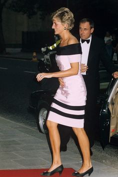 1991 - The Princess wore an off-the-shoulder pink and black dress, teamed with a pair of kitten heels, to Sadler's Wells Theatre in London.