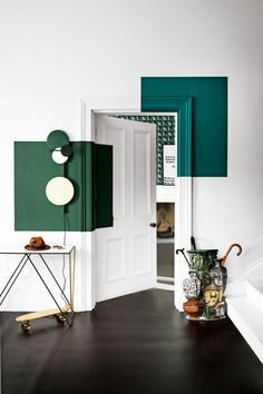 Pump up pristine walls and woodwork with graphic blocks of colour – strong green tones set the scene for a warm, embracing space. #colourblockwalls #decoratingwithgreen #statementwalls
