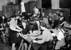 Dress-making class, London, 1943. How did WW2 change the way people dressed? Despite air raids and austerity, style was not in short supply in World War Two. An exhibition at the Imperial War Museum looks at how conflict abroad meant fashion at home had to change. Clothing coupons limited what most people could buy and government rules directly impacted on the styles available. But amid the cutbacks, there was still colour. #WorldWarII #WWII #history #WorldWar2 #WW2 #fashion #England #UK