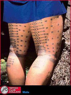 Taupou tattoo back legs view.