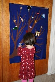 Make a tree flannel with a variety of pieces for children to add