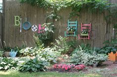 "Junk Garden in Bloom - Just had to show this one to the hubby. Our fence backs up to ""woods"" between our neighborhood and the next one and I want to do something fun with our fence. This could be cute with the pool and my new flower beds."
