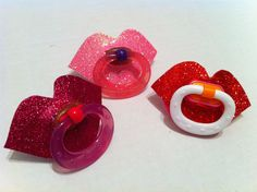 Sparkle lips novelty pacifier for baby girls!  The sparkle lips are made from glitter foam paper that is adhered to the pacifier...........just make not worth 10$