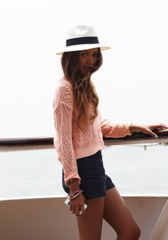 High waisted shorts + long sleeve knit top + panama hat