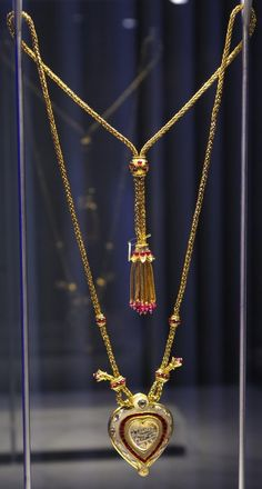 The Cartier-designed Taj Mahal diamond and ruby necklace, was a 40th birthday present from her husband Richard Burton. This is from the collection of Shah Jahan's father Jahangir and is inscribed in Persian with his wife Nur Jahan's name. The diamond was then given to Shah Jahan, who gave it to his favourite wife Mumtaz as a token of his love. And when she died, he built her the Taj Mahal.Burton bought the Taj Mahal diamond for Taylor in 1972, because he couldn't give her the Taj Mahal.
