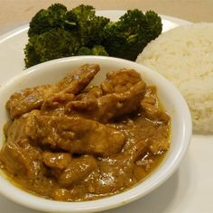 """Spicy Pork Curry Recipe """"This delicious curry has just the right amount of heat but it can be adjusted to any taste. Delicious served over lemon-coconut scented rice. Pork And Apple Recipe, Pork Curry Recipe, Pork Tenderloin Recipes, Pork Recipes, Roast Brisket, Game Recipes, Beef Tenderloin, Supper Recipes, Savoury Recipes"""
