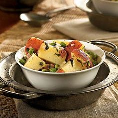 Most potato salads use mayonnaise or sour cream as the base for their dressing. These spuds are tossed in a minty oil-and-vinegar dressing that coats each bite–but with less fat than the creamy traditional dressing.