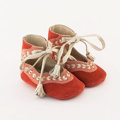 Coral pink leather baby shoes with beige leather stitch embellishment. $55.00, via Etsy.