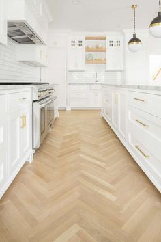 "Open, airy, simple yet inviting. ""White oak wood floor in herringbone pattern in white kitchen. White English farmhouse style home by The Fox Group. Come be inspired these English Farmhouse Style Decorating Ideas. Wood Floor Design, Herringbone Wood, Herringbone Hardwood Floors, Kitchen Design, Herringbone Wood Floor, White Shaker Kitchen, House, Floor Design, White Shaker Kitchen Cabinets"