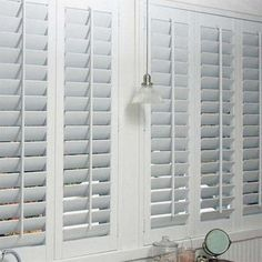 Keep kids safe by choosing cordless window coverings like shutters. These faux wood shutters are safe for high humidity areas like bathrooms. Interior Window Shutters, Interior Windows, Wood Shutters, Kitchen Shutters, Kitchen Shutter Blinds, Window Shutters Inside, White Shutter Blinds, White Wood Blinds, Bay Window Shutters