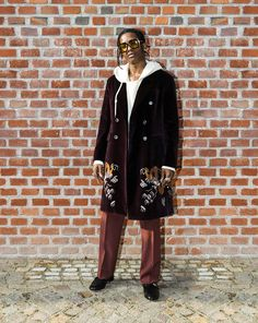 A$AP Rocky attended the first unified Gucci fashion show, the Fall Winter 2017 collection in a Gucci embroidered dragon coat, sweatshirt and loafers.
