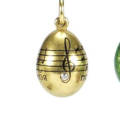 A jewelled gold miniature pendant egg by Fabergé, St. Petersburg, before 1899, the ovoid body enriched with diamond-set score from Lermontov's 'Demon'.
