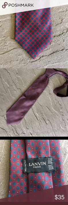 """Lanvin Vintage Men's Tie This an authentic Vintage Designer Lanvin Nevk Tie. It is not brand new & has been worn but it is in excellent condition and no signs of wear or stains. The most it will need is ironing. The pattern colors are Navy, dark red and a little gray. Please look closely at the pictures to see the patten and colors.  Approximate Measurements 57""""L 3 1/4""""W. 100% Silk Made In Italy Lanvin Accessories Ties"""