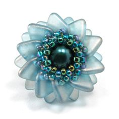 Pinwheel by Cindy Holsclaw - ($9 tute) features the new 2-hole triangle beads.  Her samples are lovely and worth a look.  #Seed #Bead #Tutorials