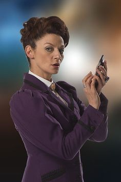 ''Missy the Master '' played by Michelle Gomez - publicity pic -- Doctor Who Series 8 and 9 (BBC One - Photo Galleries: Doctor Who - Character Profiles) (Doctor Who - BBC Series) source: http://www.bbc.co.uk/programmes/profiles/xCgpqKWg8nj5BS2LJ6DRV0/missy ; ''Missy has at last revealed her true identity to the Doctor… She is his old enemy, formerly known as the Master!''