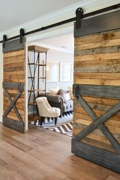 To give your barn doors a more industrial look, paint a wood trim to resemble metal. Learn more at Young House Love.