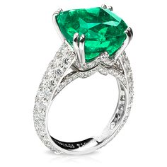 One of the dramatic one-of-a-kind single-stone rings in the Solyanka Treasure collection, this ring is set with an exceptional cushion-cut emerald of 8.37 carats, and enclosed in a refined setting of stylised swags and a shank entirely of diamonds, totalling 1.81 carats
