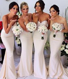 Fitted, cream bridesmaid dresses with a little bit of sparkle at the top.