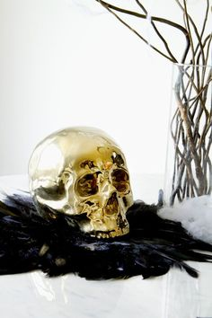 Dress up your coffee table this Halloween with a super shiny gold accent skull. The metallic tones will add light to your overall fall decor.