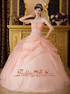Romantic Baby Pink Quinceanera Dress Strapless Organza Beading Ball Gown  http://www.fashionos.com  http://www.facebook.com/fashionos.us  This quinceanera dress will make you like an angel. This gown is strapless with a sweetheart neckline. Ruching adds texture and stones are sprinkled throughout the bust. Sheer, cloudy ruffles form an angelic skirt to highlight the celestial look of this wonderful creation. This gown is full length