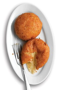 "Malakoffs / Swiss Fondue Fritters. ""A decadent mixture of Gruyere, garlic, wine, and kirsch is scooped onto bread rounds and fried to perfection—golden and crisp outside, gooey inside."" Vegetarian. Saveur"