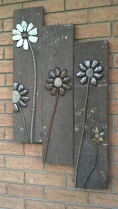 My first $0 project.  I used E6000 to glue the rocks and twigs to an old board then hung it next to my front door.
