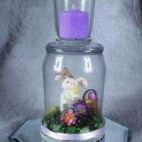 """Hippy Hoppity Easter is on its way.  Decorate your table with our hurricane centerpiece with a votive candle or our set of wine glasses with a  3""""x 3"""" candle on a 5"""" octagon table mirror.  You can choose from a wine glass with a clear stem or ones with a lavender stem. Candles also come in either..."""