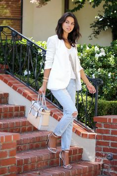 Annabelle Fleur is wearing a beaded top from Assali Ghysele, white twisted blazer from Helmut Lang, tote from Reed Krakoff and ankle straps ...
