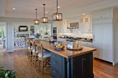 Beautiful coastal kitchen by SLC Interiors - love the pops of blue!
