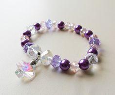 pulsera en muranos checos y perlas nacaradas dije cruz en cristal diseño de color beads.