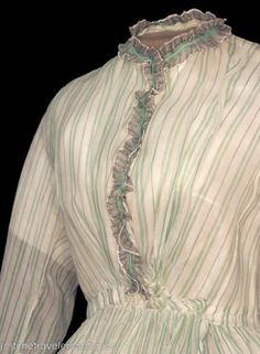 """OP said: """"1860's Sheer Dress, appears to be from Simplicity pattern. Really pretty green vertical stripe."""" I think this is an original; the """"time travelers"""" watermark is from a well-known Ebay seller of original garments."""