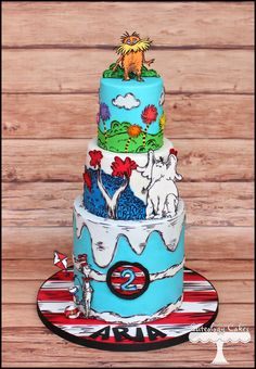 Dr. Suess cake with Cat in the Hat, Horton Hears a Who, and The Lorax. www.facebook.com/i.love.cuteology.cakes