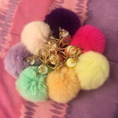 Lot of 8 Pom Pom keychain with tassel NWOT! Brand new!! Faux fur but really soft and great quality. Gold hardware.  You get 8 pom poms in different color (mint green, pink, hot pink, lilac, deep purple, light yellow and light orange)  Size: (approx) Ball Diameter = 8cm Tassel Length = 6cm  Great for your Louis Vuitton, Prada, Fendi, Chanel, Michael Kors, Gucci, Coach Tory Burch, Kate spade, Marc jacobs, Victoria's Secret, Forever 21, Nine west, Urban Outfitters, Brandy Melville, Celine and…
