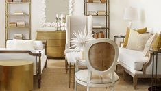 Statement Spaces - Design Chic - gorgeous white and gold design - perfect for a living room!