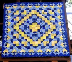 Blue and Yellow Patchwork Lap Quilt. via Etsy.