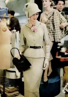 I LOVE her sophisticated style!  Look at that hat! 1957 Women's vintage fashion history clothing image photo