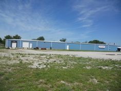 5 acres m/l with a 23,000 sq. foot building, with a loading dock, office, several bathrooms, central propane heat/ ac in the front part of the building. Concrete floors, 3 phase electric. Call for your showing today! $400,000 in Mountain View MO