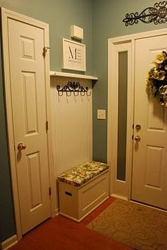 Entryway - small space maximised like the wreath and scroll over the door