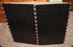 painted pegboard, laced together