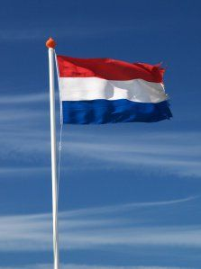 Photo about A dutch flag fluttering against a blue sky with a nice cloud pattern. Image of space, fluttering, netherlands - 8182755 Rotterdam, Utrecht, Holland Netherlands, New Holland, Leiden, La Haye, Dutch People, Going Dutch, Visit Amsterdam