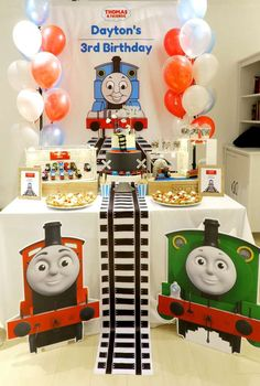 Thomas & Friends Birthday Party Ideas - Love how the backdrop continues on the table runner!