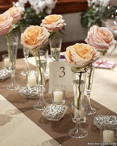 Single roses in crystal vessels make for one stunning -- and budget-friendly -- centerpeice diy-centerpieces