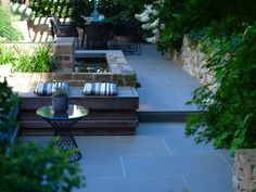 Eco Outdoor Alpine dry stone walling and bluestone paving used on rooftop…