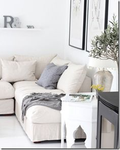 Love the white on white living room! Hexagonal Moroccan Side Table