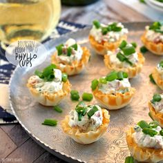 These Boursin & Prosciutto Phyllo Cups are the perfect bitesize appetizer! Perfect for wine night, the tailgate, or family holidays. YUM! #tailgate #appetizer #gameday