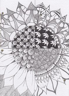 Sunflower.  each st. gets 1/4 of sunflower outline to fill w/ their own patterns, then put the flower together by virginia
