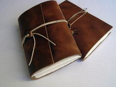 Leather journal by gabriela Irigoyen, via Flickr. Leather cover, exposed one hole sewing, wooden bead in closing detail. Size: 9,5X12,5cm, 80 pages, paper Fabriano Murillo 190g/m2.