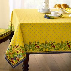 Yellow Provence tablecloth from William Sonoma - love it, but it totally doesn't match my house!